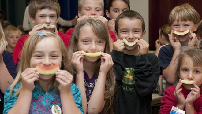 Students enjoy locally grown watermelon during the melon Harvest of the Month taste test. Through the Wood County Farm to School program, students have the opportunity to sample a new Harvest of the Month local produce item each month.