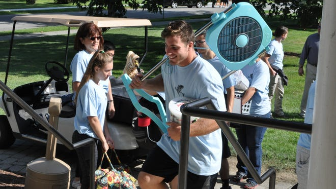 Upperclassmen help incoming freshmen move into their dorms Saturday.