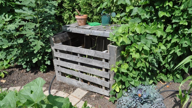 Four wooden pallets makes a nice compost bin.