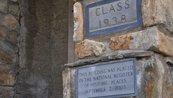 A plaque outside the old Mars Hill High School highlights the historic nature of the Rock Building.