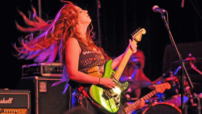 Guitarist Courtney Cox is part of the all female heavy metal band Femme Fatale.