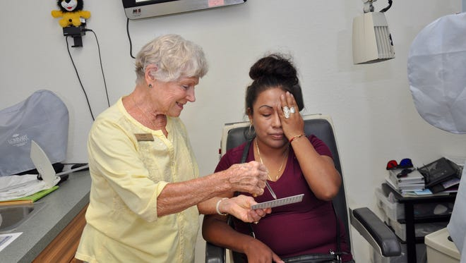 Erika Serrato, of Dade City, gets her eye checked at the Florida Lions Eye Clinic in Bonita Springs.