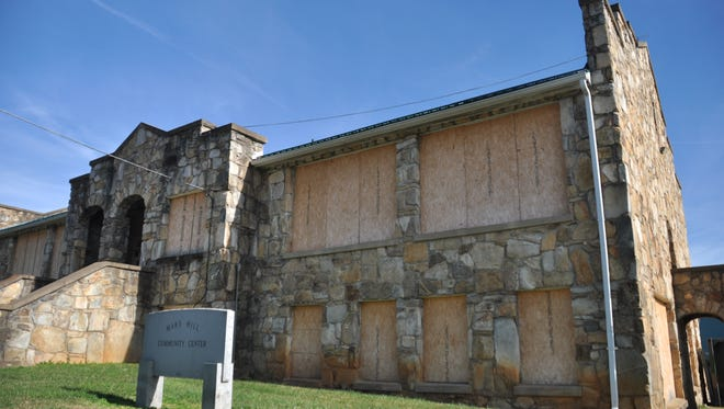 The old Mars Hill High School, known locally as the rock building, has been vacant since it closed as a community center.