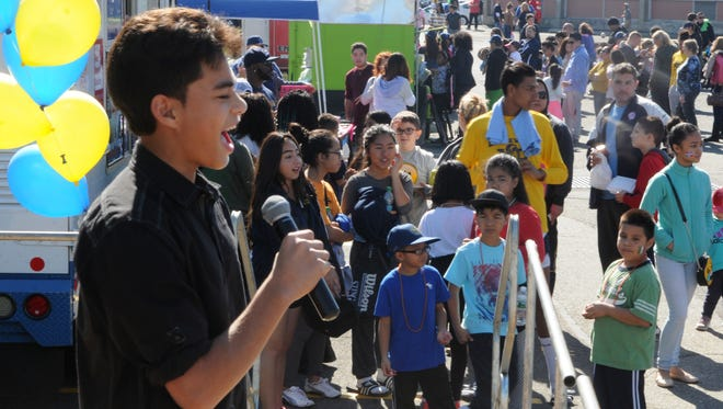 In this 2016 file photo, then-eighth-grader Michaelangelo Santiago of Belleville sings 'Duele Corazon' at the Belleville Public schools Hispanic Heritage Festival. The school district will hold its third annual Hispanic Heritage festival on Saturday, Oct. 21, 2017.