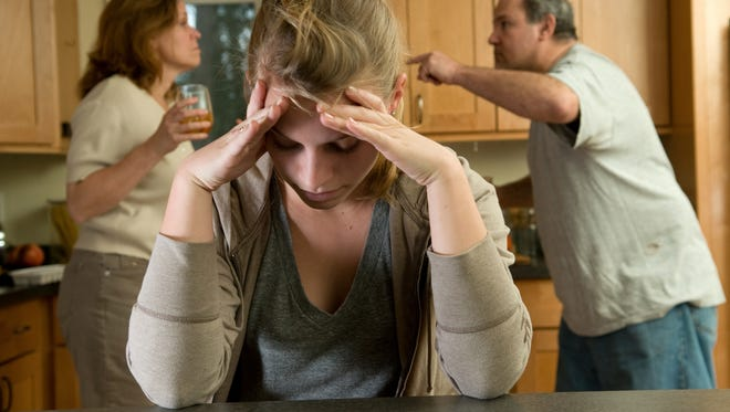 Teen daughter struggles as parents fight behind her