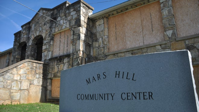 A new bid for the old Mars Hill High School could see the rock building transformed into an affordable housing complex.