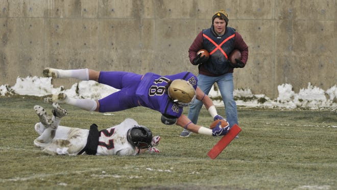 Carroll College's Eric Dawson dives for the pylon in a game this season. The former CMR star was named to the Frontier Conference First-Team Offense this year.