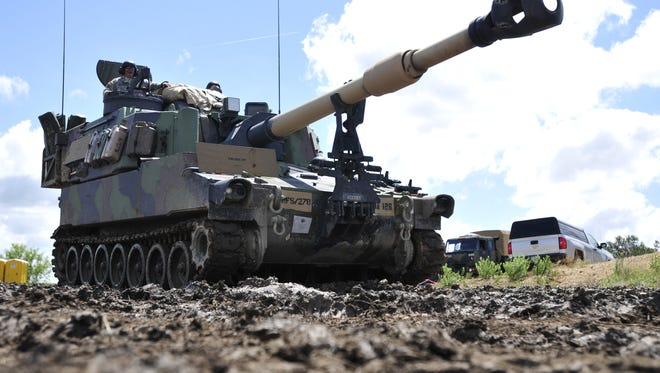 Soldiers assigned to the 278th Armored Cavalry Regiment, drive a Paladin M109A6 Artillery System to its desiginated location in preperation for a rehearsal convoy during the Army National Guard's eXportable Combat Training Capability program June 6, 2017, at Fort Hood, Tx. XCTC is designed to prepare the 278th ACR for the National Training Center at Fort Irwin, Cali., and ultimately for future deployments. (Photo by U.S. Army Spc. Lauren Ogburn/released)