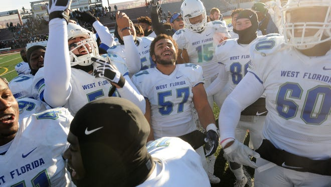UWF players celebrate at midfield following Saturday's 27-17 win over Indiana (Pa.) in the NCAA Division II semifinals in Indiana, Pennsylvania.