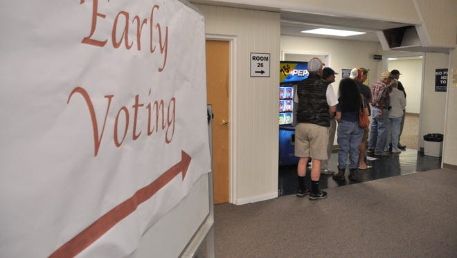 Voters line up in Marshall to cast ballots on the first day of early voting during the 2016 presidential election. Local elections officials discussed the possibility of cutting back or eliminating entirely early voting in Hot Springs.