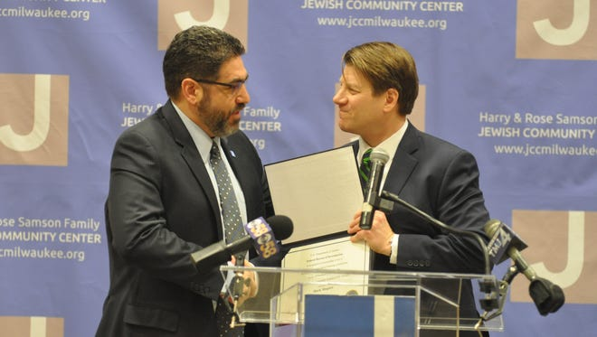 Harry and Rose Samson Family Jewish Community Center President Mark Shapiro, left, accepts the FBI Director's Community Leadership Award from Justin Tolomeo, special agent in charge of the Milwaukee Division of the FBI, on Wednesday, Jan. 17.