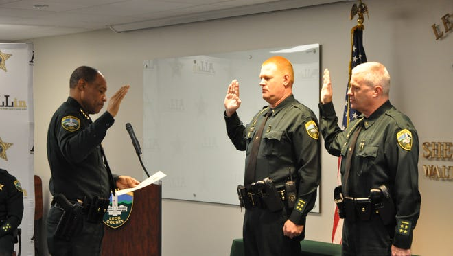 Sgt. Keith Luce and Sgt Shannon Black are sworn as lieutenants  by Sheriff Walt McNeil Wednesday.