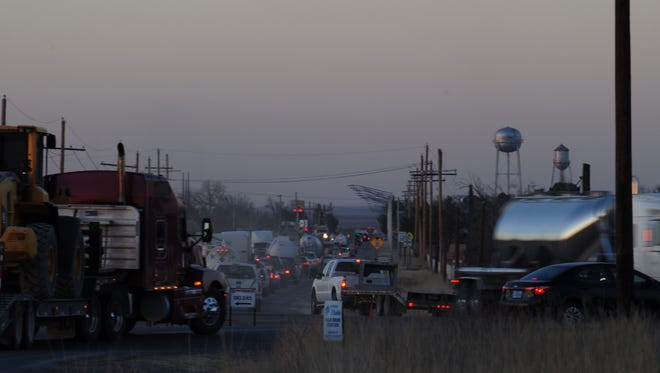 Traffic on U.S. Highway 285 Feb. 8 near Loving, New Mexico begins to roll slowly as miles of highway is lined with large commercial vehicles.