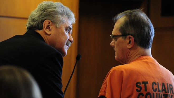 Rick Bud Currie, 62, confers with his lawyer, Robert Carson, Tuesday in District Judge John Monaghan's courtroom. Currie, a former jeweler and goldsmith, pleaded guilty to six counts of larceny by conversion.