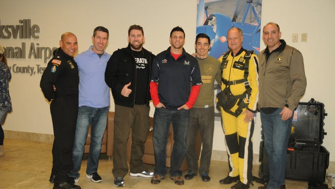 """Maj. Gen. Andrew Poppas (right), 101st Airborne Division (Air Assault) commander, poses with Lt. Col. Carlos Ramos (left), U.S. Army Parachute Team """"Golden Knights"""" commander, and Key community leaders during a two-day tandem parachute skydiving event facilitaed by the """"Golden Knights"""" at Outlaw Field, Clarksville Regional Airport, March 2 -3, 2018. The event was part of the Total Army Recruitment Effort which aims to expand Army awareness by introducing Centers of influence (key community leaders) and servicemembers to some of the capabilities and opprtunities that the U.S. Army has to offer."""
