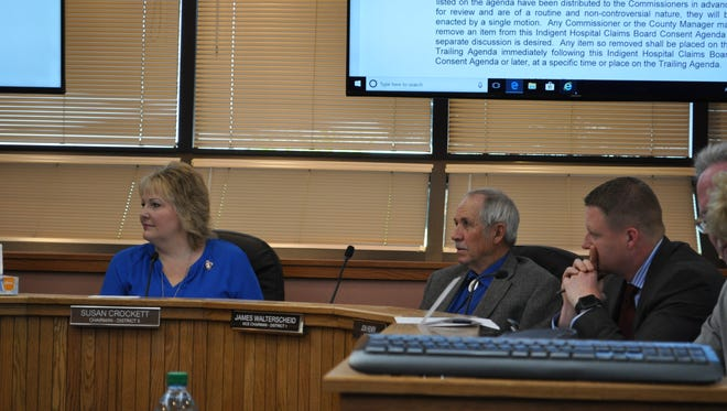 County commissioners discuss business at Tuesday's meeting, April 3, 2018.