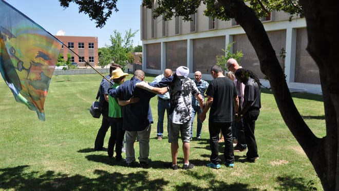 Participants at 1Kingdom National Day of Prayer event at Abilene City Hall on May 3 divided into small groups to pray during part of the program. An event at City Hall is not planned next week.