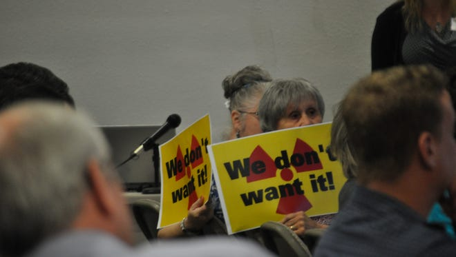 "Signs stating ""We don't want it"" were displayed by those in opposition to a proposed spent nuclear fuel rod storage facility near Carlsbad, N.M."