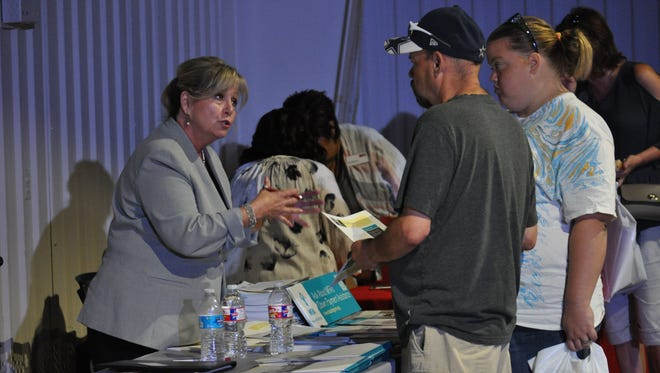 Teri Baca with the Mortgage Finance Authority speak with attendees at the Carlsbad Housing Summit Wednesday, May 16, 2018. The summit was designed for current and potential homeowners to learn about mortgage opportunities and current housing developments in the community.