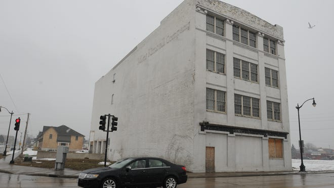 The old Miles Kimball building sits vacant on the corner of West Ninth Avenue and South Main Street in this 2013 file photo.