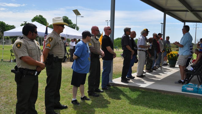 More than 10 local veterans stand in recognition in the annual Memorial Day ceremony Monday, May 28, 2918, at the Veterans Memorial Park in Carlsbad.