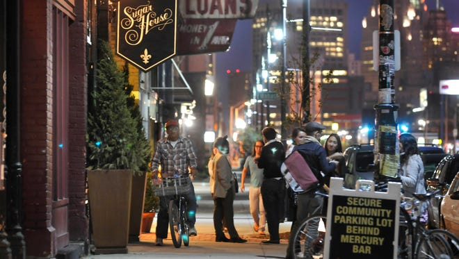Crowds are seen outside the Sugar House and Slows Bar-b-que along Michigan Avenue in Detroit.