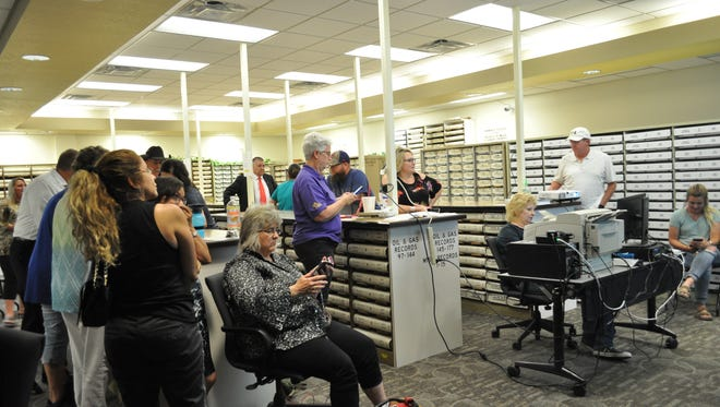 Candidates and their families, along with county staff and officials, waited for results of the primary election at the Eddy County Clerk's Office Tuesday, June 5, 2018.