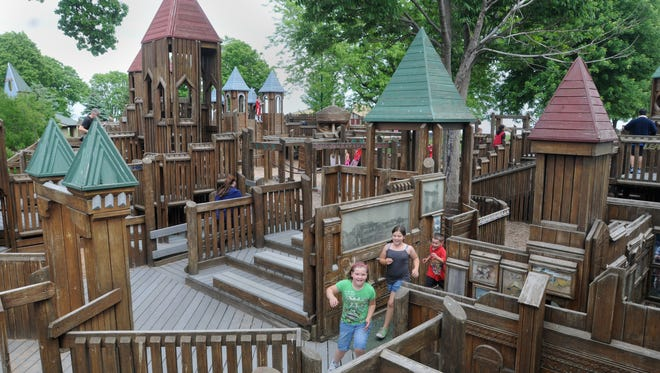 Kids play at Little Oshkosh in Menominee Park in this 2013 file photo.
