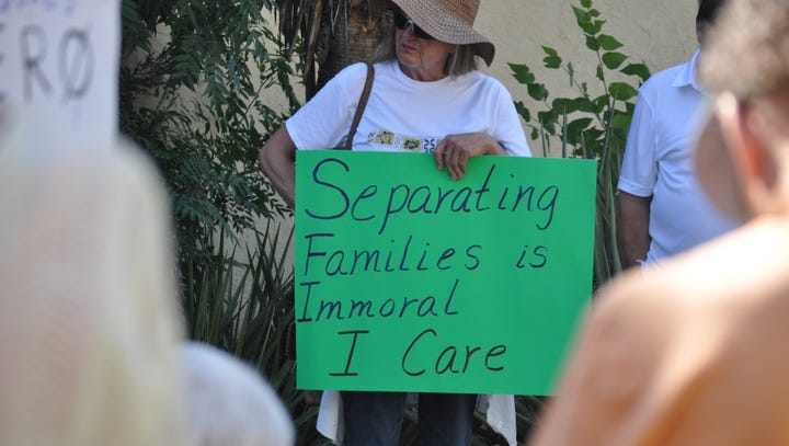 Several people brought signs at a rally Saturday, June