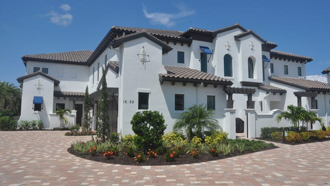 FrontDoor Communities opened a new coach home model in Corsica at Talis Park. There are four units per building.