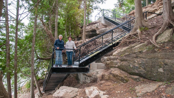 Porte des Morts Stairs visitors & contributors, Susan, left, and Mary Touscany stand on the second landing on the new stairway at Porte des Morts Town Park.