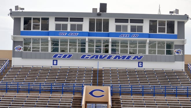 The press box at Ralph Bowyer Cavemen Stadium shows off the new Caveman (right) and Cavegirl (left) designs.