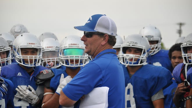 Carlsbad head coach Gary Bradley talks to his team following a practice in early August.