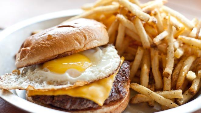 Barnyard Brawl burger with fries at Big Al's Burgers and Dogs.