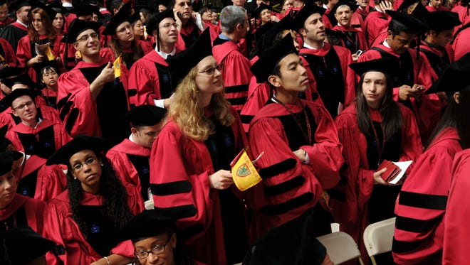 Harvard University students attend commencement in 2009.