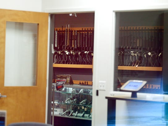Guns are visible Wednesday from outside RTSP, a firearms