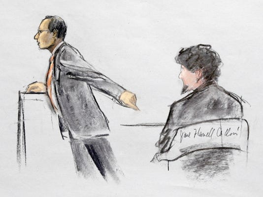 In this courtroom sketch, Assistant U.S. Attorney Aloke Chakravarty is depicted pointing to defendant Dzhokhar Tsarnaev, right, during closing arguments in Tsarnaev's federal death penalty trial Monday, April 6, 2015, in Boston. Tsarnaev is charged with conspiring with his brother to place two bombs near the Boston Marathon finish line in April 2013, killing three and injuring 260 people.