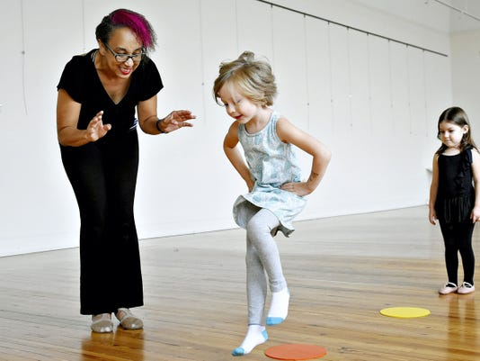 Dance instructor Warkenda Williams-Casey works with Lotus DeGrace, 5, of York Township while Carisa Acosta, 5, of York City waits her turn during ballet class Saturday at Marketview Arts. Watch the class learn new moves in a video at yorkdispatch.com.