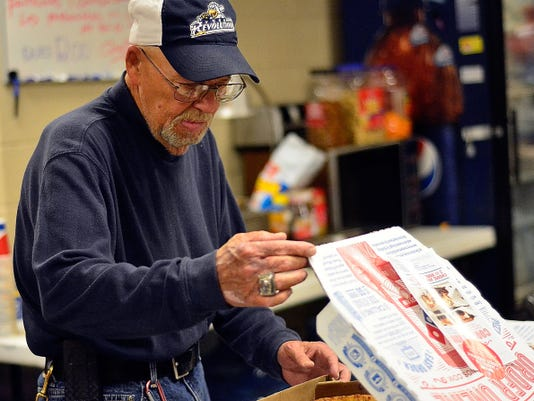York Revolution visiting clubhouse attendant Everett George makes sure the Long Island Ducks have plenty of pizza after Wednesday's game.