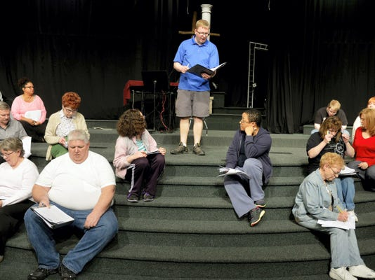 """Stillmeadow Church of the Nazarene worship pastor John Farley, center, directs church members during a rehearsal of """"The Scribe"""" at the church's Manchester Township campus. The play this year is a performance featuring tenor Paul Pitts and the church's own Drama Disciples and Celebration Singers."""