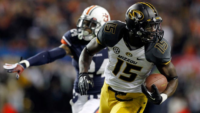 Missouri wide receiver Dorial Green-Beckham (15) runs for a touchdown pass against Auburn during the second quarter of the 2013 SEC Championship at Georgia Dome.