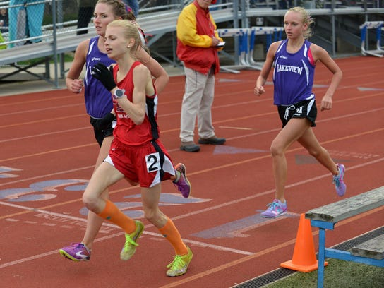 Runners compete in the 3,200-meters at the All-City