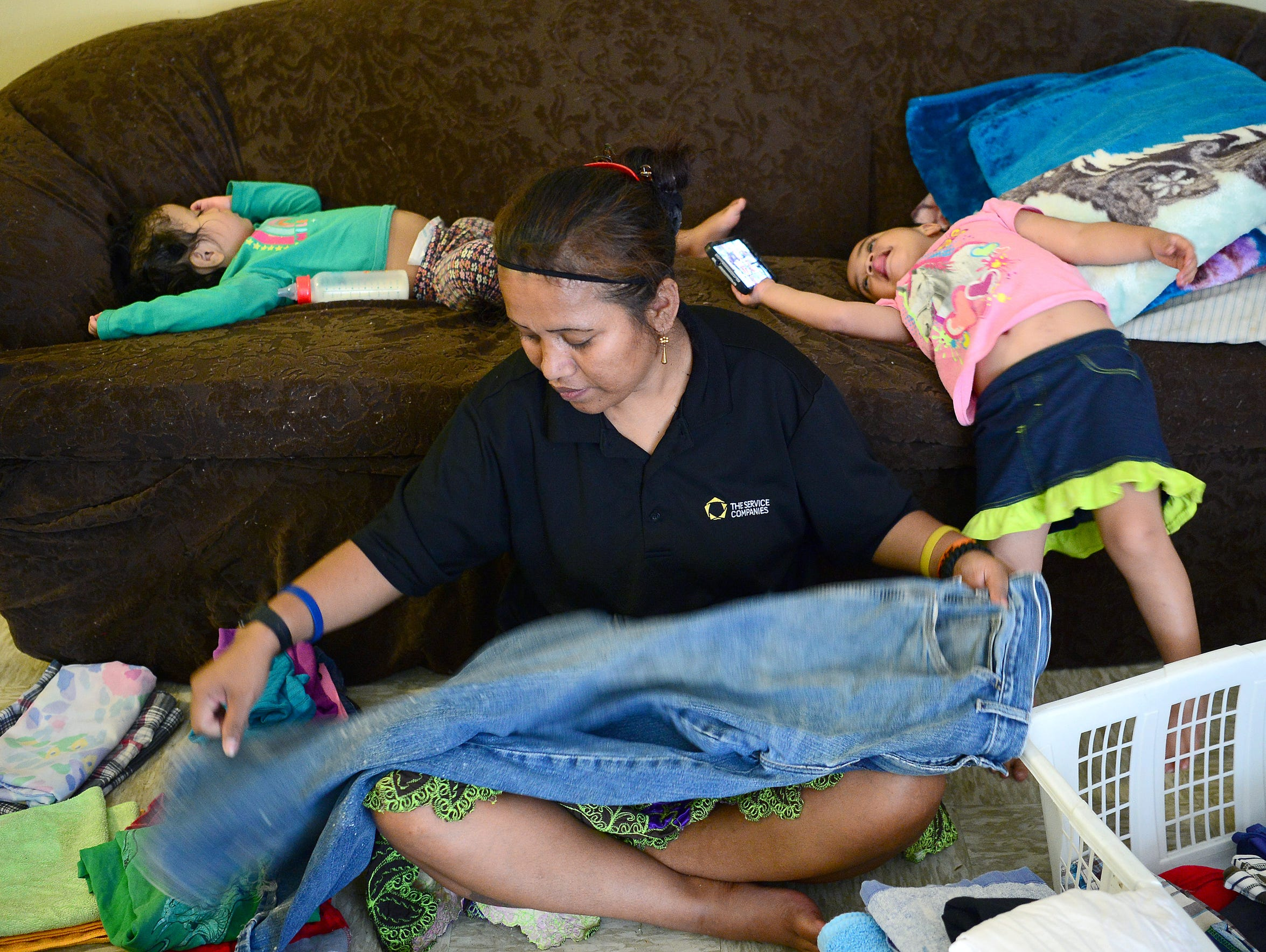 Deaverview resident Elena Jacklick folds clothes as