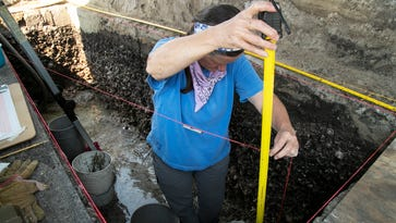 Karen Walker, an archaeologist with the University of Florida, measures the depth where she was looking for artifacts from the Calusa at the Pineland dig site on Friday, March 18, 2017.