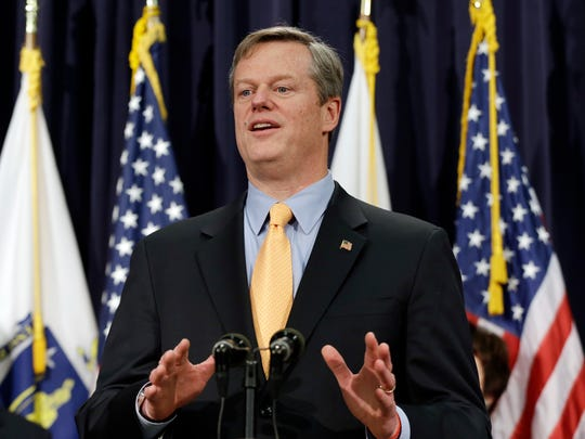 Gov. Charlie Baker speaks to reporters at the Statehouse in Boston.