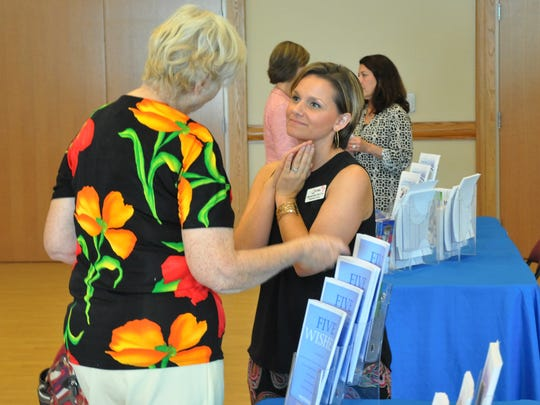 Visiting Nurse Association staff welcomed questions from caregivers during the conference.