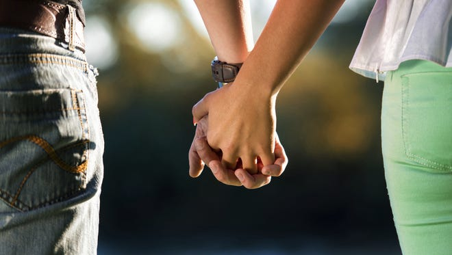 Stock image of couple holding hands