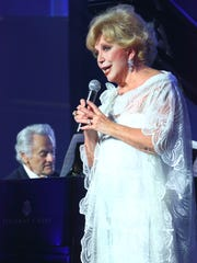 Bill Marx on piano and Ruta Lee give tribute to Gloria Greer in word and song at the Black & White Gala benefiting the Waring International Piano Competition.