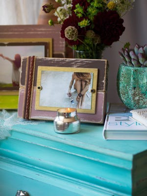 New Orleans-based Alyse studio owner Alyse Rodriguez, who makes artistic wooden picture frames and rustic home decor.