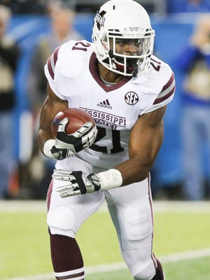 Mississippi State running back Nick Gibson runs the ball in the first half of an NCAA college football game against Kentucky Saturday in Lexington, Ky.